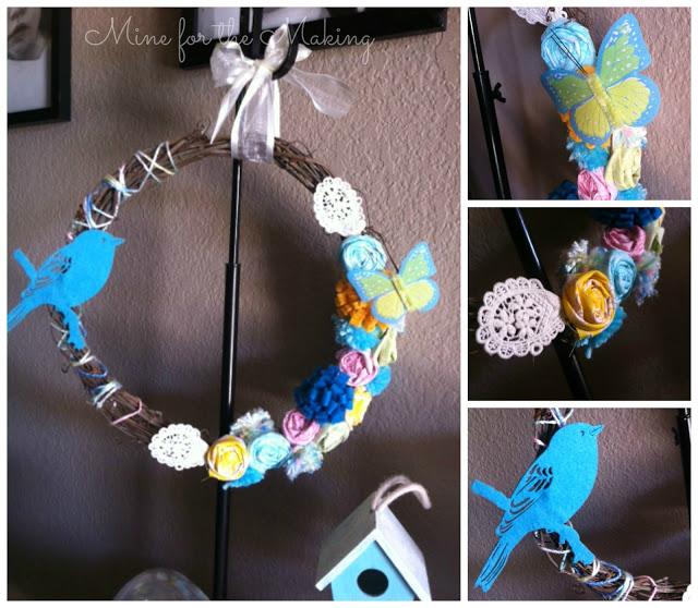 Corona con flores, mariposa y pájaros de fieltro